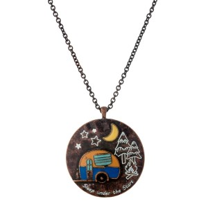 """Rustic copper tone necklace with a circle pendant, stamped with """"Sleep under the stars"""" and a camper accent. Approximately 33"""" in length."""