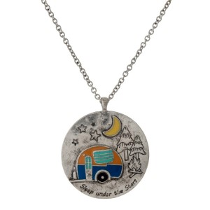 """Silver tone necklace with a circle pendant, stamped with """"Sleep under the stars"""" and a camper accent. Approximately 33"""" in length."""