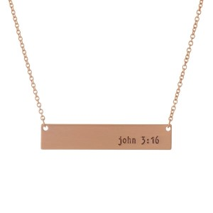 """Dainty rose gold tone necklace with a bar pendant, stamped with """"John 3:16."""" Approximately 16"""" in length."""