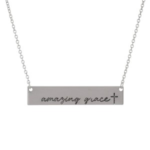 """Dainty silver tone necklace with a bar pendant, stamped with """"Amazing Grace."""" Approximately 16"""" in length."""