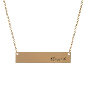 """Dainty gold tone necklace with a bar pendant, stamped with """"blessed."""" Approximately 16"""" in length."""