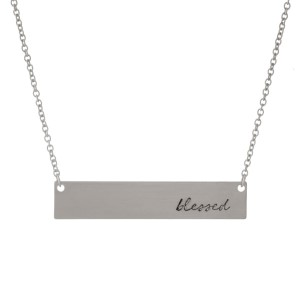 """Dainty silver tone necklace with a bar pendant, stamped with """"blessed."""" Approximately 16"""" in length."""