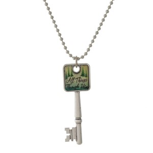 """Silver tone necklace with a key pendant that says """"All Things Through Him."""" Approximately 26"""" in length."""