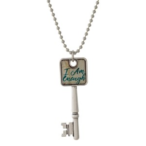 """Silver tone necklace with a key pendant that says """"I am Enough."""" Approximately 26"""" in length."""