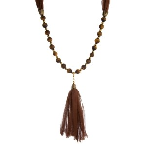 "Burnished gold tone necklace with brown beads and a fabric tassel. This can be worn as a wrap bracelet by unclipping the tassel. Approximately 32"" in length."