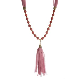 """Burnished gold tone necklace with mauve beads and a fabric tassel. This can be worn as a wrap bracelet by unclipping the tassel. Approximately 32"""" in length."""