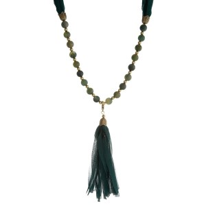 """Burnished gold tone necklace with hunter green beads and a fabric tassel. This can be worn as a wrap bracelet by unclipping the tassel. Approximately 32"""" in length."""