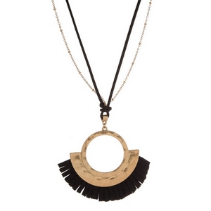 "Faux leather and gold tone necklace with a hammered, circle pendant with a fanned tassel. Approximately 30"" in length."
