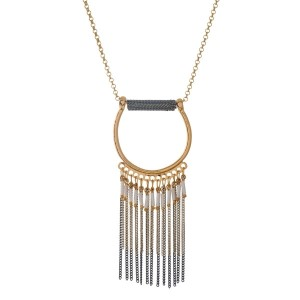 """Gold tone necklace with a gold tone half circle pendant and chain fringe. Approximately 32"""" in length."""