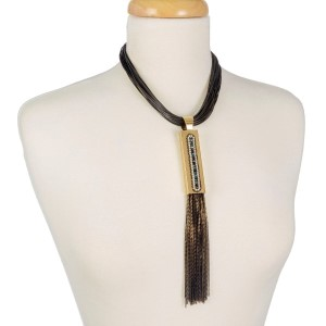 """Black, faux leather 'Y' necklace with a black chain tassel and gold tone accents. Approximately 16"""" in length."""