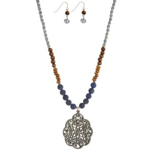 """Corn necklace set with wooden and natural stone beads, a laser cut wooden pendant, and matching fishhook earrings. Approximately 30"""" in length."""
