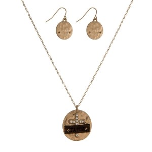 """Dainty necklace set with a geometric shaped and wooden pendant stamped with """"Faith"""" and matching fishhook earrings. Approximately 16"""" in length."""