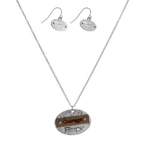"""Dainty necklace set with a geometric shaped and wooden pendant stamped with """"Courage"""" and matching fishhook earrings. Approximately 16"""" in length."""