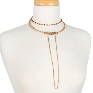 Copper tone, metal choker with three chain layers and neutral colored beads.