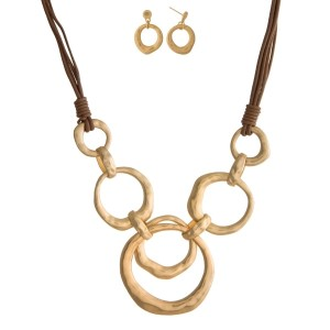 Leather cord necklace set with an interlocking circle pendant, a matte finish and matching fishhook earrings.