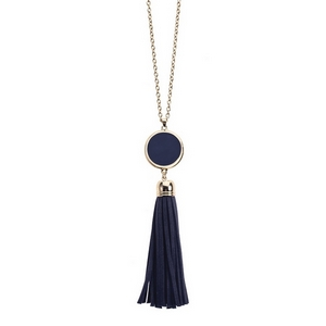 "Gold tone necklace with an enamel disc and faux suede tassel pendant. This necklace is perfect for vinyl monogramming and completes your gameday look! Approximately 30"" in length."