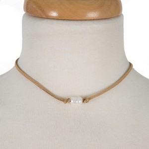 """Faux suede necklace with a freshwater pearl bead. Approximately 14"""" in length."""