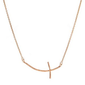 "Dainty metal necklace with a curved, East-West cross pendant. Approximately 26"" in length."