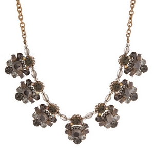 "Gold tone statement necklace with clusters of gray and opal rhinestones. Approximately 16"" in length."