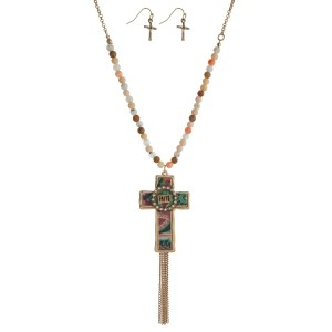 """Gold tone necklace set with a patterned cross pendant stamped with """"Faith"""", a chain tassel, and matching fishhook earrings. Approximately 32"""" in length."""
