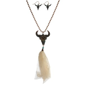 """Copper tone necklace with a patina skull pendant, an ivory fabric tassel and matching fishhook earrings. Approximately 32"""" in length."""