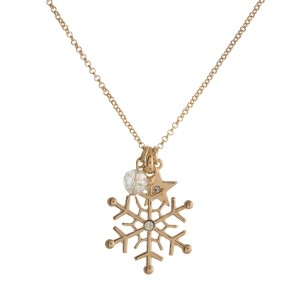 "Dainty metal necklace with a snowflake pendant and iridescent bead charm. Approximately 18"" in length."