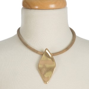"""Short, faux leather necklace with a hammered oval shaped pendant. Approximately 13"""" in length."""