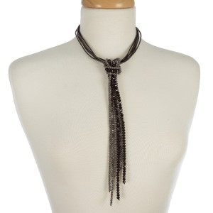 "Black cord necklace with a gray and black beaded tassel. Approximately 14"" in length."