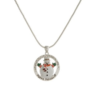"Silver tone necklace with a circle shaped, snowman pendant stamped with ""Happy Holiday."" Approximately 18"" in length."