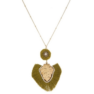 """Gold tone necklace with a hammered, bohemian pendant and fanned, thread tassels. Approximately 32"""" in length."""