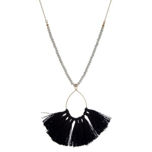 """Gold tone necklace with beaded accents along the body and a fanned, thread tassel pendant. Approximately 30"""" in length."""