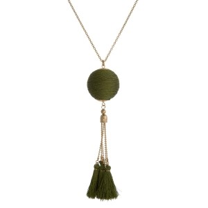 """Gold tone necklace with a metallic olive green thread wrapped pendant and thread tassels. Approximately 30"""" in length."""