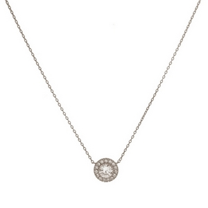 """Dainty metal necklace with a circle shaped, rhinestone pendant. Approximately 16"""" in length."""