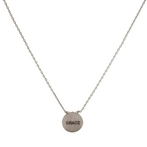 "Dainty metal necklace with a circle pendant, stamped with ""Grace."" Approximately 16"" in length."