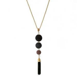 """Gold tone necklace with three, chain wrapped beads and a chain tassel. Approximately 32"""" in length."""