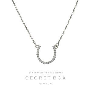 "Secret Box 24 karat white gold over brass horseshoe pendant necklace. Approximately 16"" in length. Sold in gift box."
