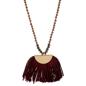 """Full beaded necklace with a faux leather, fanned tassel pendant. Approximately 27"""" in length."""