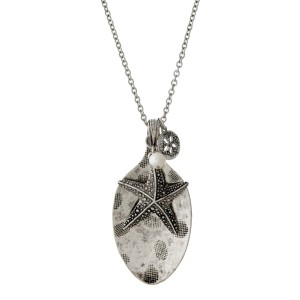 "Burnished silver tone metal necklace with a spoon pendant and a sea life theme. Approximately 30"" in length."