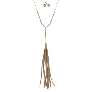 "Dainty gold tone necklace set with a faux suede tassel and matching stud earrings. Approximately 25"" in length."