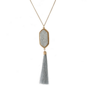 """Gold tone necklace set with a faux druzy and thread tassel pendant. Approximately 26"""" in length."""