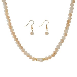 """Full beaded necklace set with a freshwater pearl bead focal and matching fishhook earrings. Approximately 16"""" in length."""