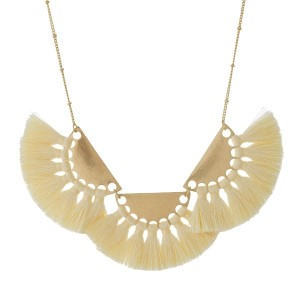 "Gold tone necklace with three half circle pendants and ivory thread tassels. Approximately 16"" in length."