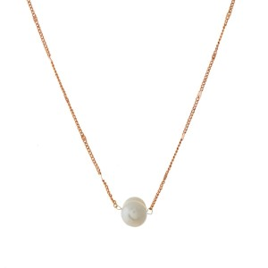 """Dainty, metal necklace with a freshwater pearl bead pendant. Approximately 16"""" in length."""