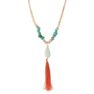 "Full beaded necklace with chip stones, a natural stone pendant and a thread tassel pendant. Approximately 26"" in length."