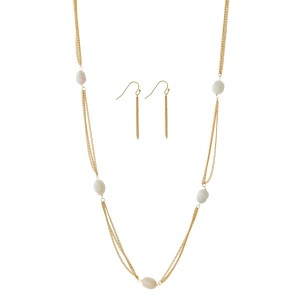 """Long, metal necklace set with freshwater pearl beads and matching fishhook earrings. Approximately 36"""" in length."""
