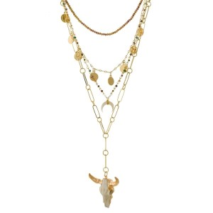 "Multi-layered, gold tone necklace with horn and skull pendants and beaded accents. Approximately 16"" to 20"" in length."