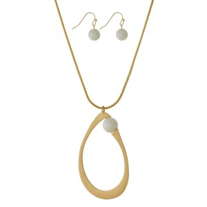 """Long, metal necklace set with a teardrop pendant and pearl bead accents. Approximately 30"""" in length."""