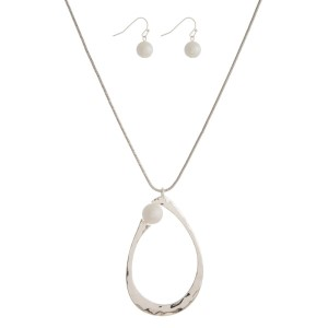 """Metal, necklace set with an open teardrop pendant, pearl bead accent and matching fishhook earrings. Approximately 32"""" in length."""