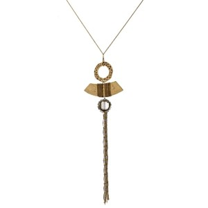 """Long, statement necklace with a hammered geometric pendant and beaded tassel. Approximately 30"""" in length."""