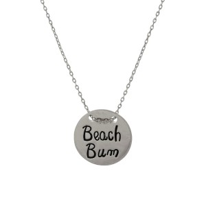 "Dainty necklace with a circle pendant stamped with a beach theme. Approximately 16"" in length."